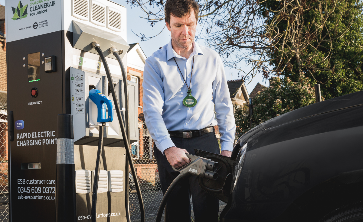 Man charging EV at ESB Energy charger
