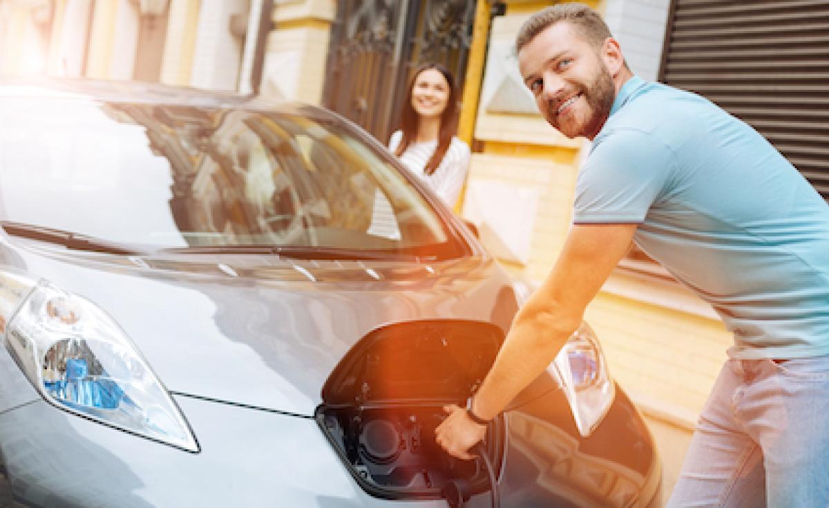 Man charging EV